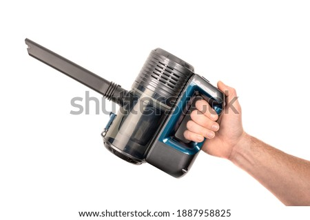 hand holding a modern battery-powered vacuum cleaner. isolated on white background. Cordless vacuum cleaner. Stock photo ©