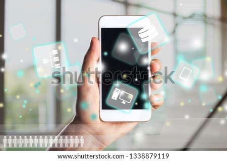 Hand holding a new phone