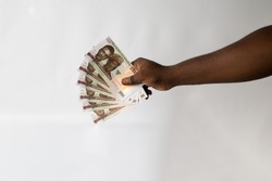 Hand holding a Nigeria bank note