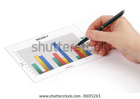 Hand holding a pen showing a diagram on financial report