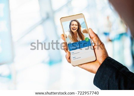 hand holding a phone. beautiful caucasian woman making incoming call
