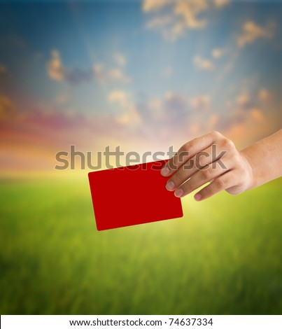 Hand holding a red card