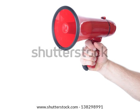 Hand holding a red Megaphone isolated on white