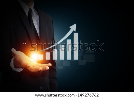 Hand holding a rising arrow, representing business growth. #149276762