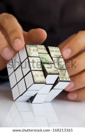 hand holding a rubik's cube,money concept