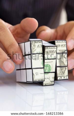 hand holding a rubik's cube,money concept