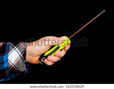 Hand Holding a Screwdriver isolated on black