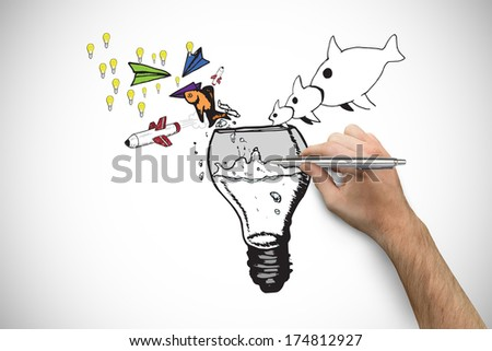 Hand holding a silver pen against white background with vignette