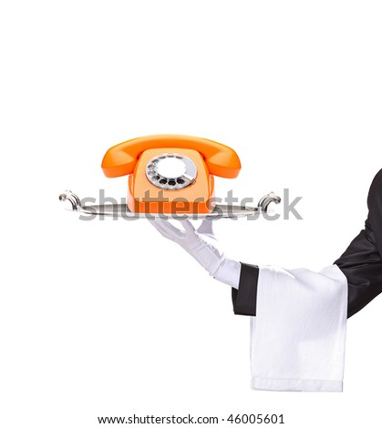 Hand holding a silver tray with an orange telephone on it isolated on white background