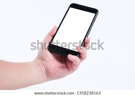 Hand holding a smart phone showing blank white screen isolated with white background #1358238563