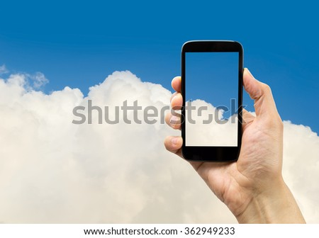 hand holding a smartphone is photographing the clouds on a cloud background