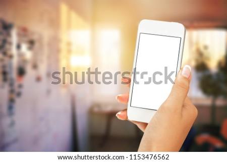 Hand holding a smartpone #1153476562
