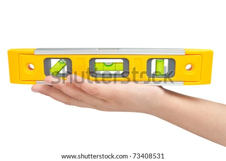 Hand holding a spirit lever isolated on a white background with clipping path
