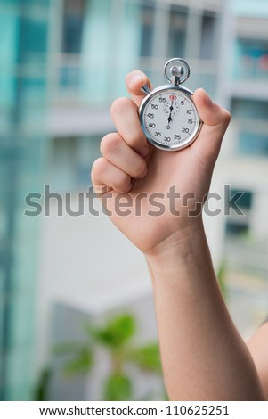 Hand Holding A Stopwatch, Outdoor