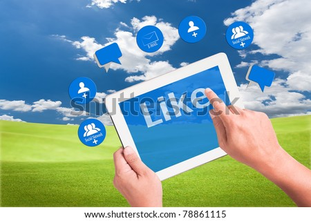 hand holding a touchpad pc and press like button with mail , add friend and comment icons