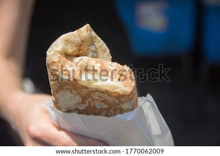 Hand holding a traditional rolled Druze Pita bread, Daliyat al-Karmel, Israel Сток-фото ©