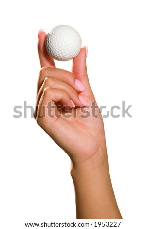 hand holding a white golf ball isolated