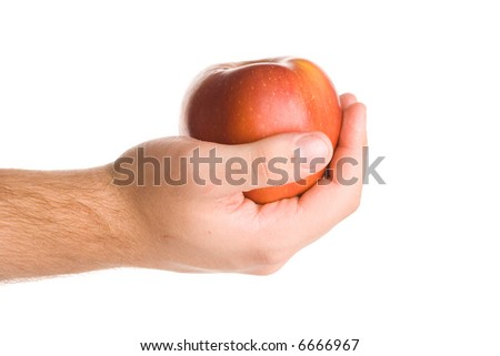 Hand holding an red apple