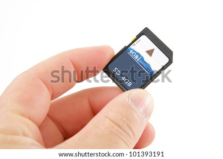 Hand holding an SD card