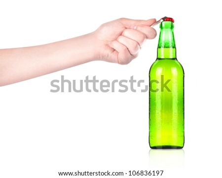 hand holding and opening beer bottle with metal opener