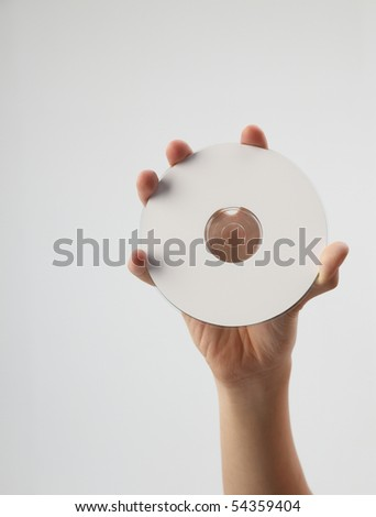 hand holding and showing a printable cd