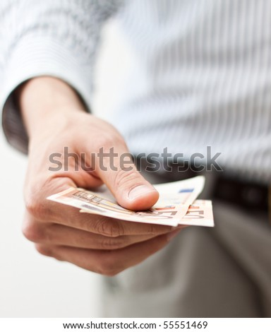 Hand holding banknotes