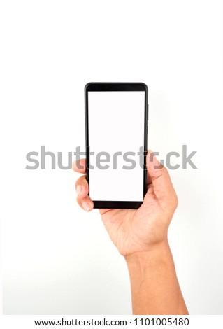 Hand holding black smartphone on white background #1101005480