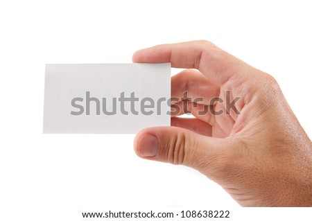 Hand holding blank business card over white background