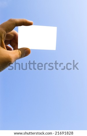 hand holding blank card on blue sky isolated with clipping path