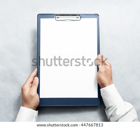 Hand holding blank clipboard with white a4 paper design mockup. Clear document holder mock up template hold arm. Clip board notepad surface display front. Checklist tablet plan file presentation.