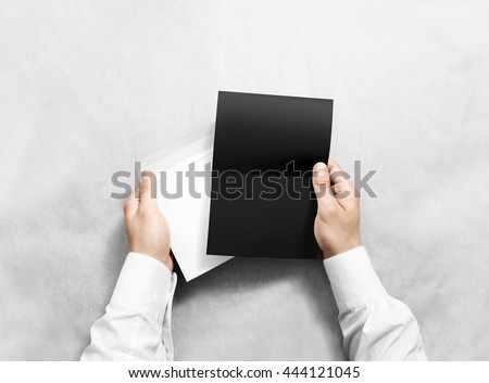 Hand holding blank envelope and black letter mockup, isolated. Arm hold grey brochure template mock up. Greeting card leaflet surface design. Invitation print display show. Reading writing envelope.