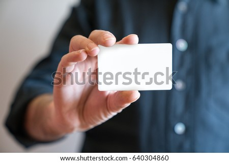 Hand holding blank white credit card mockup front side view. Plastic bank-card design mock up  #640304860