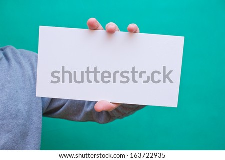 Hand holding blank white space desk advertising empty place