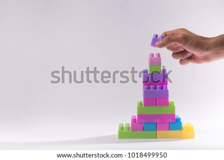 Hand holding block for upper. Concept for success, business. #1018499950
