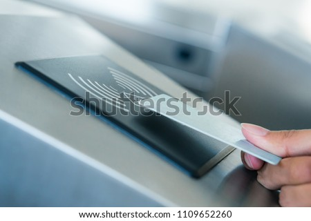 Hand holding Blue Card to access Electronic Entrance Scanner, Security Technology
