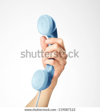 hand holding blue handset, closeup