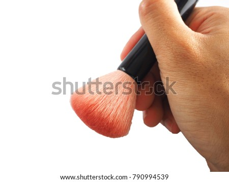 Hand holding blush brush isolated on white background for makeup on face painting.Cheek Brush #790994539