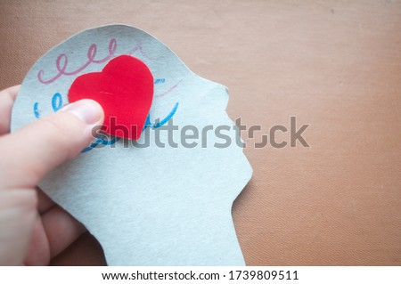 Hand holding brain cut paper brain encephalography, epilepsy awareness, epilepsy, mental health concept. World Brain Tumor Day. World Alzheimer's Day. World Parkinson's Day.