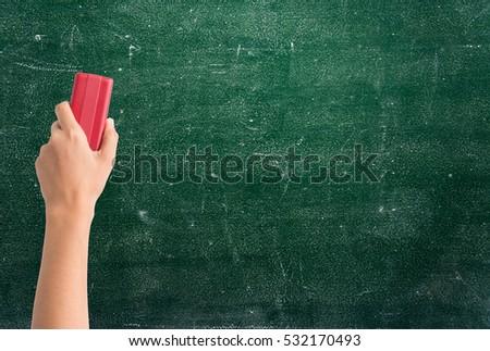 hand holding brush erase on...