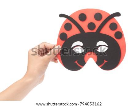 Hand holding Bug carnival mask isolated on white background