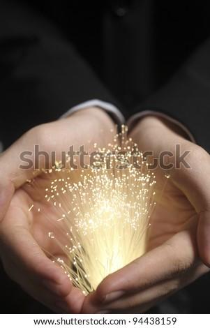 hand holding bundlle of fiber optic