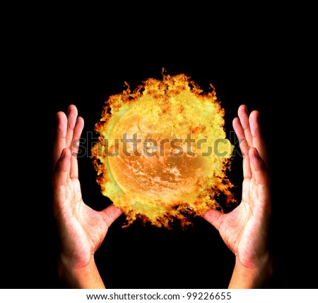 "Hand holding burning earth ""Elements of this image furnished by NASA"""
