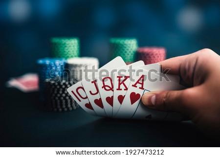 hand holding cards, poker chips casino background  Zdjęcia stock ©