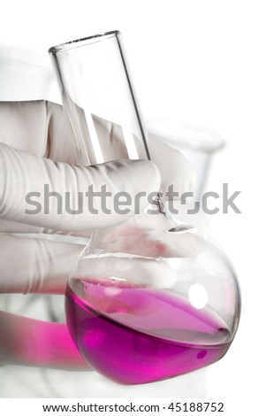 hand holding chemical flask isolated