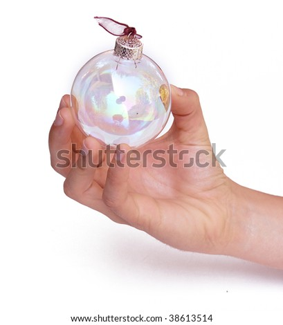 Hand holding Christmas ornament