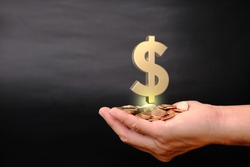 hand holding coins on black background and Business growth concept, finance and dollar sign