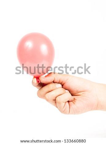 Hand holding colorful helium balloons isolated on white background