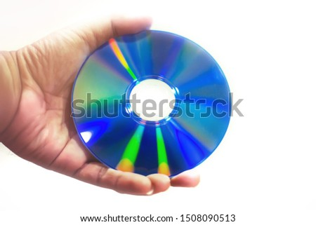 Hand holding compact disc on isolated white background