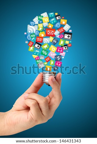 Hand holding creative idea with cloud of colorful application icon, Business software and social media networking service concept