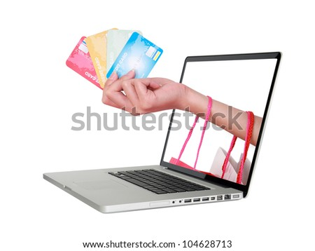 Hand holding credit card and shopping bag.